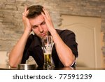 Desperate man. Indoor shoot. Pub, drinking bar. - stock photo