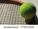 tennis ball and wooden racket  | Shutterstock . vector #775912594