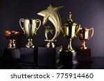 golden trophy on the black... | Shutterstock . vector #775914460