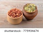 pumpkin seeds and peanut on... | Shutterstock . vector #775934674