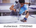 young cutter on cloth textile... | Shutterstock . vector #775935460