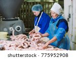 butchers processing sausages at ...   Shutterstock . vector #775952908