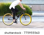 modern sports guy cycling... | Shutterstock . vector #775955563