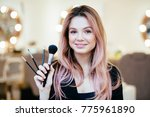 makeup artist with brushes in... | Shutterstock . vector #775961890