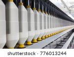 rolls of industrial cotton... | Shutterstock . vector #776013244