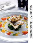 sea bass on spinach - stock photo