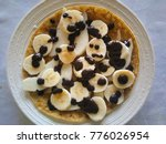 banana crepe with chocolate | Shutterstock . vector #776026954