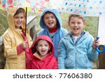 Children Posing With Umbrella