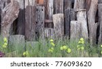 Wooden Poles In The Field And...