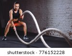 Woman Training With Battle Rop...