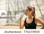 fit girl drinking water  | Shutterstock . vector #776173924