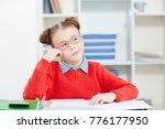 pensive schoolgirl sitting by... | Shutterstock . vector #776177950