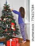 little girl in winter pajama... | Shutterstock . vector #776217184