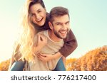 young couple walk in the autumn ... | Shutterstock . vector #776217400
