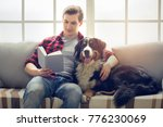 young person with dog at home... | Shutterstock . vector #776230069