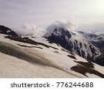 clouds touching the top of... | Shutterstock . vector #776244688
