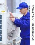 male technician repairing... | Shutterstock . vector #776259523