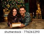 couple with christmas present   Shutterstock . vector #776261293