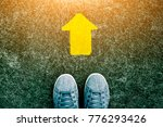 feet and arrows on road. | Shutterstock . vector #776293426