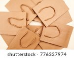 many brown paper bags with...   Shutterstock . vector #776327974