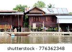 Small photo of Wood house adjoin river in rural in Thailand