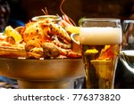 a glass of beer in the... | Shutterstock . vector #776373820