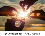 collaborate four hands trying... | Shutterstock . vector #776378416