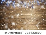christmas lights on a rustic... | Shutterstock . vector #776423890