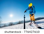 male skier dropping his camera... | Shutterstock . vector #776427610
