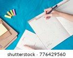 woman planning agenda and... | Shutterstock . vector #776429560