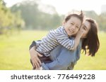 mother and son  in the field.... | Shutterstock . vector #776449228