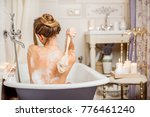 young woman washing with brush... | Shutterstock . vector #776461240