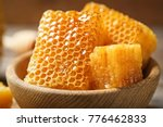 Fresh honeycombs in wooden bowl ...