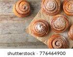 sweet cinnamon rolls on table | Shutterstock . vector #776464900