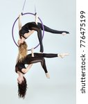 two women are balancing at the... | Shutterstock . vector #776475199