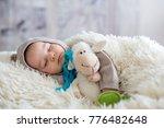 sweet baby boy in bear overall  ... | Shutterstock . vector #776482648