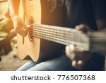 teenager girl playing guitar on ... | Shutterstock . vector #776507368