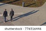Two Men Walks On The Street...