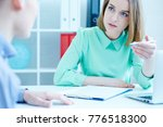 young female employee of the... | Shutterstock . vector #776518300