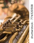 Small photo of Closeup of antique tuba musical instrument