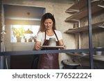 female artisan standing alone... | Shutterstock . vector #776522224