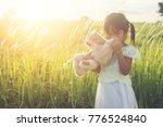 little girl in white dress... | Shutterstock . vector #776524840