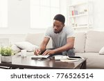 concentrated young black man... | Shutterstock . vector #776526514