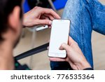 a smartphone in the hands of a... | Shutterstock . vector #776535364