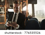 smiling young businessman... | Shutterstock . vector #776535526