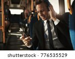 smiling young businessman... | Shutterstock . vector #776535529