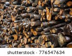 pile of cut timber background | Shutterstock . vector #776547634