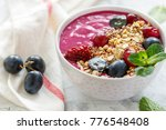 red smoothie bowl with beets ... | Shutterstock . vector #776548408