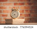 vintage alarm clock and old... | Shutterstock . vector #776594524