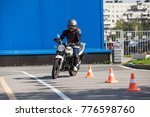 woman l driver driving slalom... | Shutterstock . vector #776598760